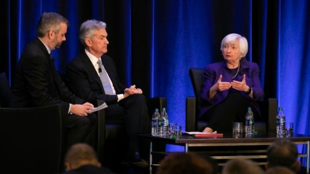 Fed officials, determined to restore the job market and push inflation to 2% on a persistent basis